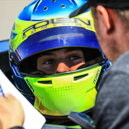 pilot one racing | kaylen frederick | kaylen looking at manager through visor